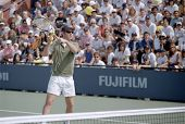 FLUSHING, NY - AUGUST 28: John McEnroe demonstrates some moves as he attends the US Open Kids Day in Arthur Ashe Stadium August 28, 1999 in Flushing NY.