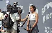 FLUSHING NY - AUGUST 28: Tennis player Alexandra Stevenson answers reporter questions at the Arthur Ashe Kids Day in Arthur Ashe Stadium August 28, 1999 in Flushing NY.