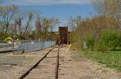 picture of trestle bridge  - Some rail road tracks leading to a trestle - JPG