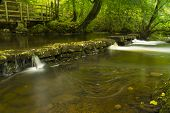 stock photo of anglesey  - Long exposure of small waterfalls The Dingle  - JPG