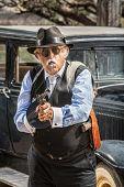 Male Gangster Aiming Machine Gun
