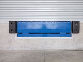 image of roller shutter door  - Dock leveler and shutter door  use for product transfer to truck - JPG