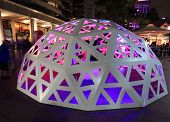 People Interacting With Geodesic Light Dome