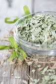 Dried Tarragon In A Small Bowl