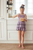 7 years old school girl cooking on the vintage kitchen, casual lifestyle photo series