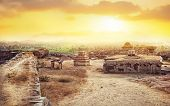 stock photo of karnataka  - Hemakuta hill sunset point with ancient ruins in Hampi Karnataka India - JPG