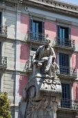 Old Statue In Barcelona Plaza