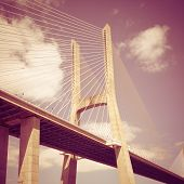 Vasco da Gama bridge in Lisbon, Portugal with retro effect.