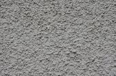 Grey Rough Plaster On Wall Closeup