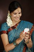 Happy Young Traditional Woman Text Messaging