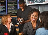 Cheerful Woman In Cafe