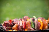 foto of barbie  - Delicious grilled meat skewers on fire - JPG