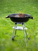 foto of ember  - Empty grill on garden with burning embers - JPG