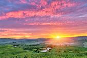 stock photo of sunrise  - Beautiful Tuscany landscape at sunrise - JPG