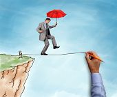 Businessman on a hand drawn tightrope and cliff holding red umbrella concept for business risk, chal