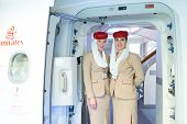 DUBAI - MAY 16: Emirates crew members meet passengers in Airbus A380 aircraft on May 16, 2014 in Dub