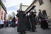 KRAKOW, POLAND - APR 18, 2014: Unidentified participants of the Way of the Cross on Good Friday cele