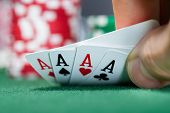 Poker Player Holding Playing Cards