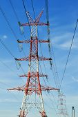 Power Pylon Over Blue Sky. Electrical Transmission Tower