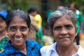 HIKKADUWA, SRI LANKA - FEBRUARY 23, 2014: Portrait of two local women at Sunday market. It is a grea
