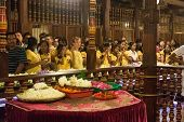 KANDY, SRI LANKA - FEBRUARY 26, 2014: Group of tourists inside the Temple of the Tooth. The Sacred T