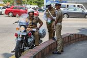 COLOMBO, SRI LANKA - FEBRUARY 22, 2014: Group of policemen standing on street. The Sri Lankan police