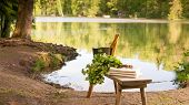 stock photo of bench  - Finnish summer landscape and sauna objects on wooden bench by lake - JPG