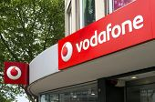 Dusseldorf, Germany - May 14, 2011: Sign at Vodafone store. Vodafone Group plc is the world's larges