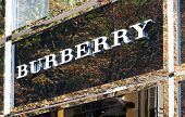 Dusseldorf, Germany - August 20,2011: Burberry logo above store entrance on Koenigsallee. Burberry Group plc is a British luxury fashion house, manufacturing clothing, fragrance, and accessories.