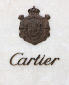 Dusseldorf, Germany - August 20, 2011: Cartier signage with coat of arms of the Cartier family on wa