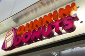 Essen, Germany - September 1, 2011: Dunkin' Donuts sign at shop entrance. Dunkin' Donuts is an inter