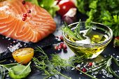 stock photo of salmon steak  - Delicious  portion of fresh salmon fillet  with aromatic herbs - JPG
