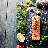 foto of gourmet food  - Delicious  portion of fresh salmon fillet  with aromatic herbs - JPG