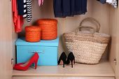 foto of shoe-box  - Female shoes and boxes in wardrobe - JPG