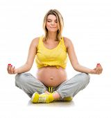 pregnant woman engaged in fitness in lotus position. Isolated on white background