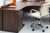 desks and white leather chairs in the office