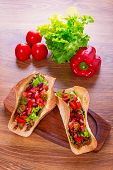 Mexican tacos in tortilla shells with fresh vegetables