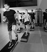 stock photo of cardio  - Cardio step dance people group at fitness gym training workout - JPG