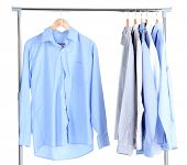 Office male clothes on hangers, isolated on white