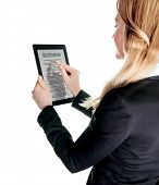 Business lady with touch pad, checking on business news, using portable mobile device, touch screen
