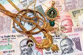 Gold Ornaments And Indian Currency