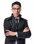 young business man standing with crossed arms over white background