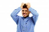 Upset man holding his head over white background