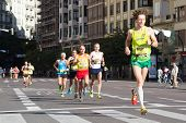 VALENCIA, SPAIN - November 16, 2014: Runners compete in the 2014 Valencia Marathon in Valencia, Spain.