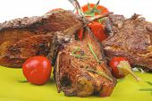 meat savory: roast ribs on green plate with peppers and chives