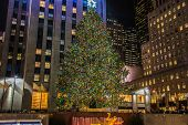 New York - DECEMBER 20, 2013: Christmas Tree at Rockefeller center on December 20 in USA, New York. Christmas Tree at Rockefeller center is the most famous christmas tree in USA