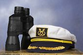 captain hat with black binoculars