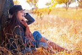 Smiling Girl In Autumn