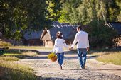 Young couple walking along the road