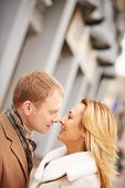 picture of amor  - Amorous man going to kiss romantic woman - JPG